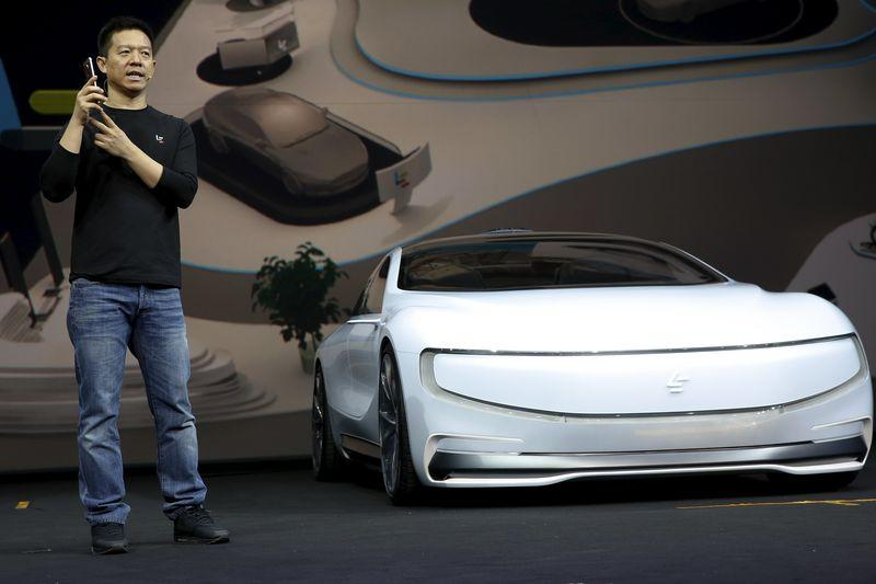 """Jia, co-founder and head of Le Holdings Co Ltd, also known as LeEco and formerly as LeTV, gestures as he unveils an all-electric battery """"concept"""" car called LeSEE during a ceremony in Beijingx"""