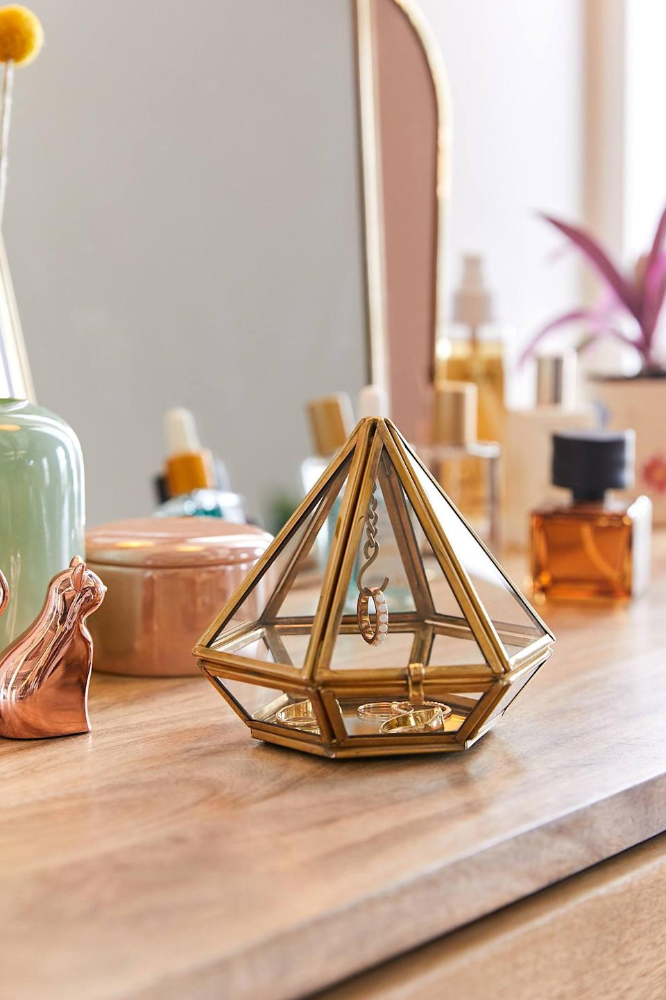 <p>Ring storage has never been cuter - we love this <span>Pyramid Display Ring Holder</span> ($18).</p>