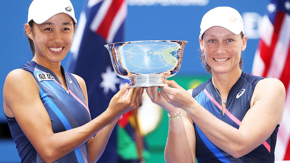 Zhang Shuai and Sam Stosur, pictured here with the championship trophy after the US Open final.
