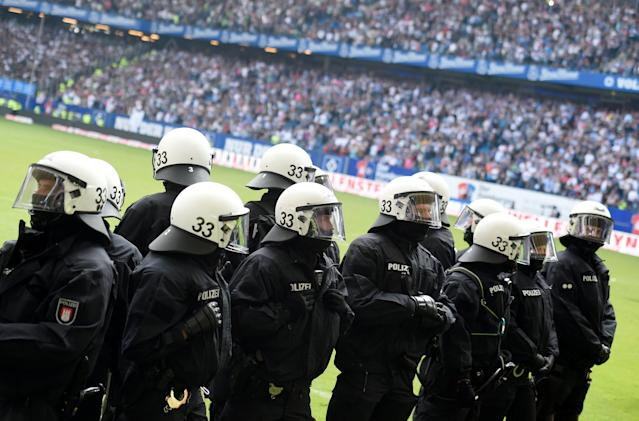 Soccer Football - Bundesliga - Hamburger SV v Borussia Moenchengladbach - Volksparkstadion, Hamburg, Germany - May 12, 2018 General view of riot police on the pitch at the end of the match REUTERS/Fabian Bimmer DFL RULES TO LIMIT THE ONLINE USAGE DURING MATCH TIME TO 15 PICTURES PER GAME. IMAGE SEQUENCES TO SIMULATE VIDEO IS NOT ALLOWED AT ANY TIME. FOR FURTHER QUERIES PLEASE CONTACT DFL DIRECTLY AT + 49 69 650050