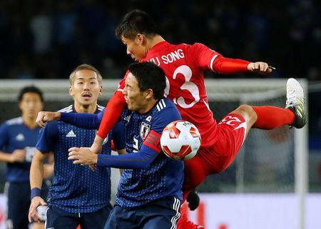 Soccer Football - East Asian Football Championship - North Korea v Japan - Ajinomoto Stadium, Tokyo, Japan - December 9, 2017. North Korea's Kim Yu Song (R) and Japan's Gen Shoji in action. REUTERS/Toru Hanai