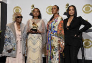 "The family of the late Nipsey Hussle, Margaret Boutte, Emani Asghedom, Samantha Smith and Lauren London pose in the press room on behalf of Nipsey Hussle with the award for best rap performance for ""Racks in the Middle"" at the 62nd annual Grammy Awards at the Staples Center on Sunday, Jan. 26, 2020, in Los Angeles. (AP Photo/Chris Pizzello)"