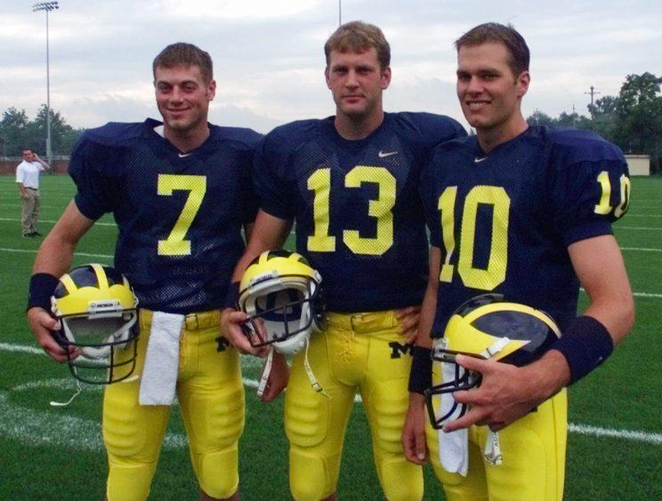 Drew Henson, (7), Jason Kapsner, (13) and Tom Brady (10) pose during Michigan's media day before the 1999 season. (AP)