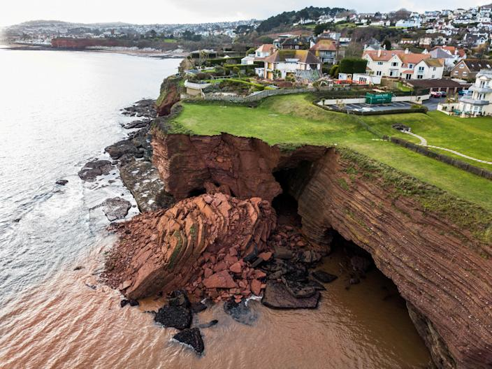 A cliff fall at Livermead cliff in Torquay, 29/01/2020  See SWNS story SWPLcliff. A huge cliff has fallen into the sea off the Devon coast. Drone photos show the dramatic scene at Livermead. It's understood the incident happened at some point yesterday. Torbay Council and the Harbour Authority took to Twitter to warn people about the collapse.