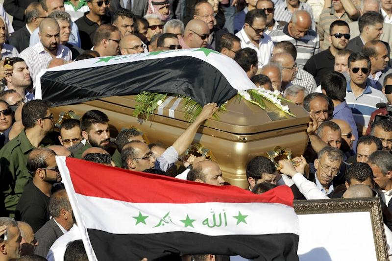 Relatives of Iraq's former foreign minister Tareq Aziz and supporters of the Baath Party in Jordan carry Aziz's coffin during his funeral in the Jordanian city of Madaba on June 13, 2015