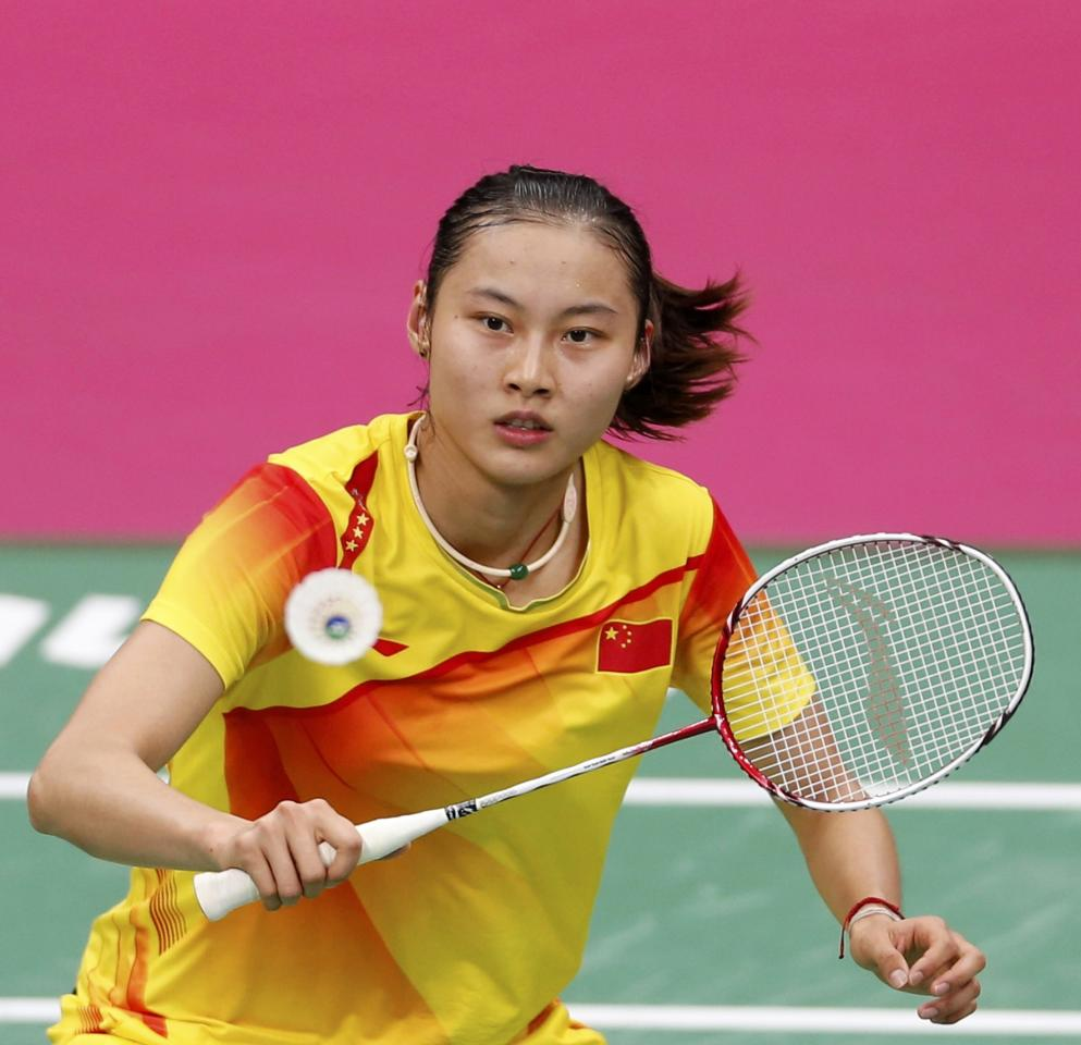China's Yihan Wang plays against India's Saina Nehwal during their womens singles badminton semifinals match during the London 2012 Olympic Games at the Wembley Arena August 3, 2012. REUTERS/Bazuki Muhammad (BRITAIN  - Tags: SPORT BADMINTON SPORT OLYMPICS)