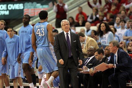 North Carolina head coach Roy Williams shows his disappointment as North Carolina State opens a large lead during the first half of an NCAA college basketball game in Raleigh, N.C., Saturday, Jan. 26, 2013. N.C. State won 91-83. (AP Photo/Ted Richardson)
