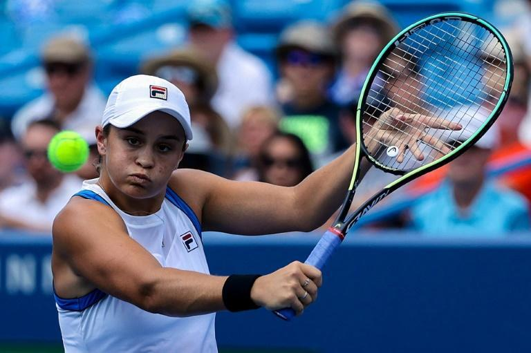 World number one Ashleigh Barty seeks to add the US Open title to the Wimbledon crown she earned this year when the final Grand Slam of 2021 begins in New York (AFP/Dylan Buell)