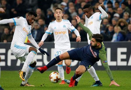Soccer Football - Europa League - Olympique de Marseille vs RB Salzburg - Orange Velodrome, Marseille, France - December 7, 2017 RB Salzburg's Moanes Dabour in action with Marseille's Andre-Frank Zambo Anguissa and Maxime Lopez REUTERS/Jean-Paul Pelissier