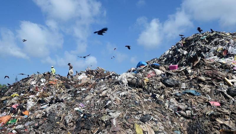 Roughly 800 tonnes of waste is added daily to the open dump in Kolonnawa, and the parliament in Sri Lanka has even been warned that the 23 million tonnes of rotting garbage poses a serious health hazard (AFP Photo/ISHARA S.KODIKARA)