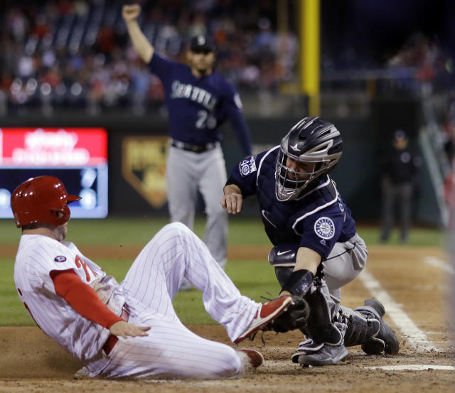 <p>Seattle Mariners catcher Tuffy Gosewisch, right, tags out Philadelphia Phillies' Daniel Nava at home as Nava tried to score on a fly-out by Maikel Franco during the eighth inning of a baseball game, May 9, 2017, in Philadelphia. Seattle won 10-9. (Photo: Matt Slocum/AP) </p>
