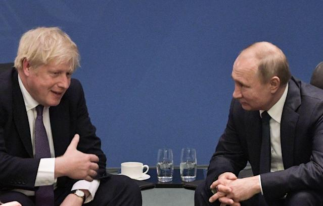 Boris Johnson and Vladimir Putin at a summit in Berlin in January. A House of Commons committee has released a report about Russian influence in the UK. (Sputnik/AFP via Getty Images)