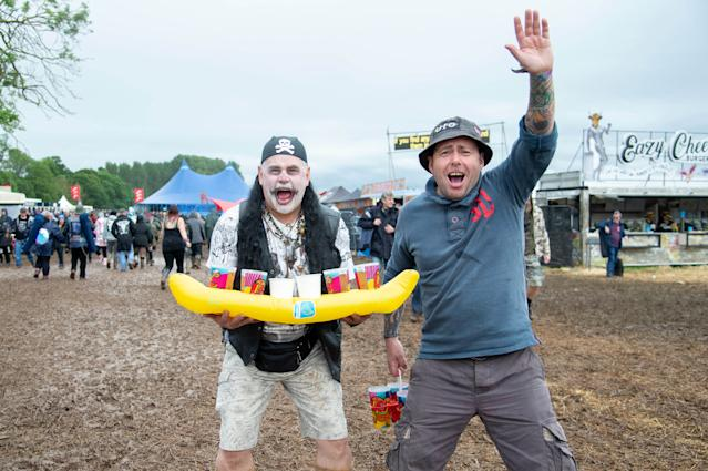 Festival goers brave the muddy fields during day 1 at Download festival 2019 at Donington Park on June 14, 2019 in Castle Donington, England. (Photo by Joseph Okpako/WireImage)