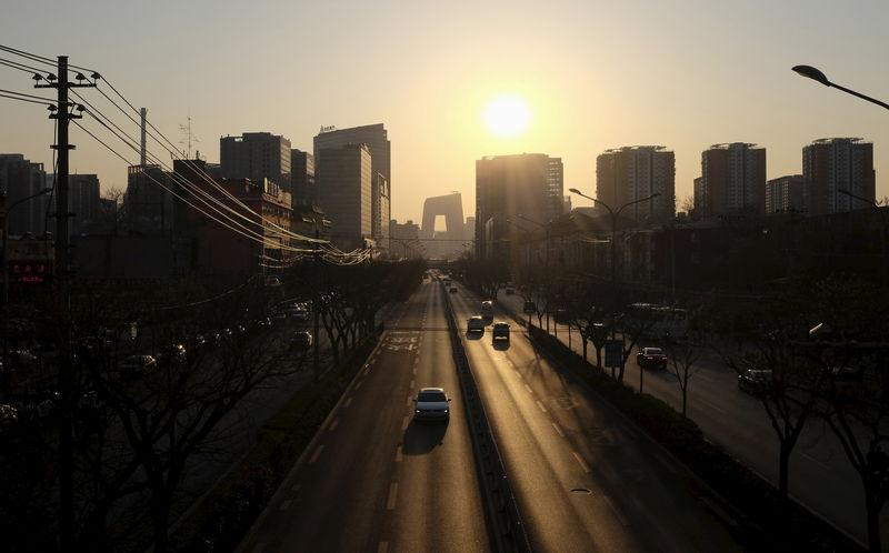 Apartment blocks are seen at sunset in Beijing
