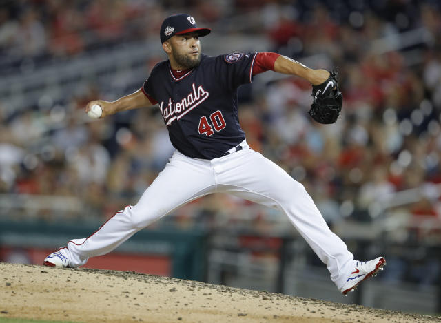 FILE - In this June 19, 2018, file photo, Washington Nationals pitcher Kelvin Herrera throws during the eighth inning of the team's baseball game against the Baltimore Orioles at Nationals Park in Washington. The Chicago White Sox have agreed to an $18 million, two-year contract with two-time AL All-Star reliever Kelvin Herrera. Under the terms of the deal announced Tuesday, Jan. 8, 2019. Herrera will earn $8.5 million in 2019 and 2020. (AP Photo/Carolyn Kaster, File)