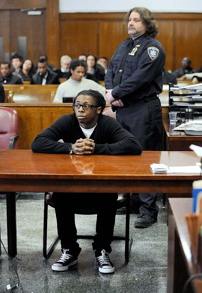"""Meanwhile, Lil Wayne (government name Dwayne Carter) has an issue of his own to deal with. The troubled star, who pleaded guilty to a gun possession charge in Manhattan, had his jail sentencing delayed for three weeks so that he can recover from dental surgery in Miami. Steven Hirsch/<a href=""""http://www.splashnewsonline.com"""" target=""""new"""">Splash News</a> - February 10, 2010"""