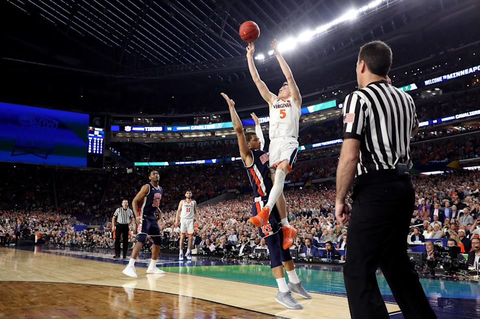 MINNEAPOLIS, MINNESOTA - APRIL 06: Kyle Guy #5 of the Virginia Cavaliers attempts a game-winning three point basket as he is fouled by Samir Doughty #10 of the Auburn Tigers in the second half during the 2019 NCAA Final Four semifinal at U.S. Bank Stadium on April 6, 2019 in Minneapolis, Minnesota. (Photo by Streeter Lecka/Getty Images)
