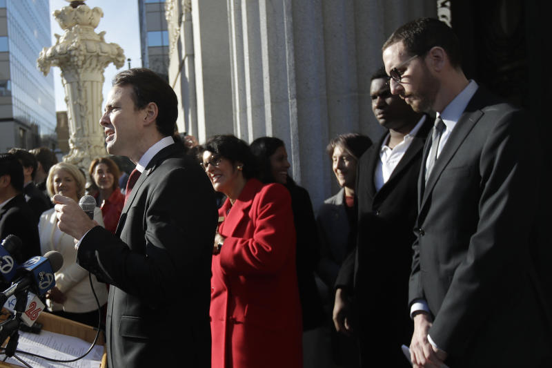 Assemblyman Kevin Kiley, R-Rocklin, left, speaks at a rally in front of California Sen. Scott Wiener, right, outside of City Hall in Oakland, Calif., Tuesday, Jan. 7, 2020. Wiener announced amendments to a closely-watched bill that would allow more housing to be built near public transportation. (AP Photo/Jeff Chiu)