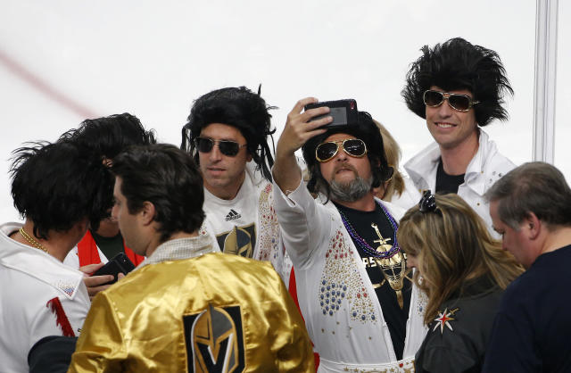 Fans dressed as Elvis Presley take selfies prior to Game 2 of the NHL hockey Stanley Cup Finals between the Vegas Golden Knights and the Washington Capitals on Wednesday, May 30, 2018, in Las Vegas. (AP Photo/Ross D. Franklin)