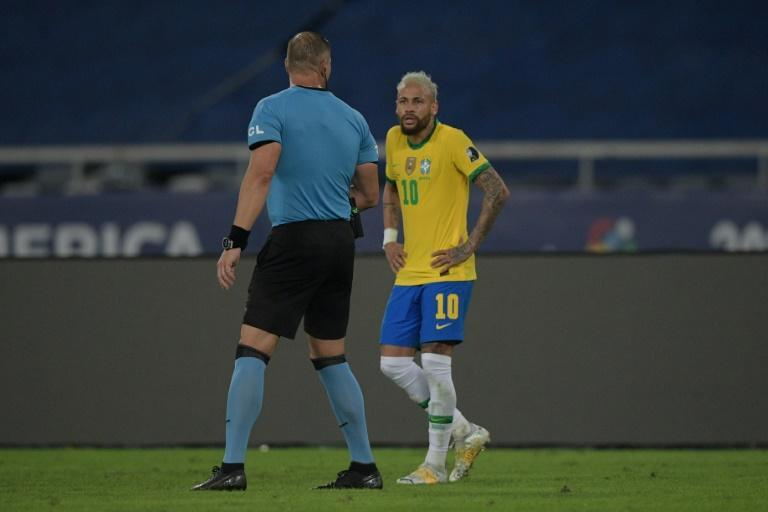 Argentine referee Nestor Pitana, left, speaks with Brazil's Neymar during the Copa America football tournament group phase match between Brazil and Colombia on Wednesday in Rio de Janeiro