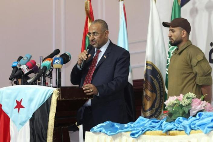 The leader of Yemen's southern separatists, Aidarous al-Zoubeidi, routinely speaks in front of the flag of the formerly independent south but says for now he is ready to hold off on independence for the sake of partnership and democracy (AFP Photo/Saleh Al-OBEIDI)