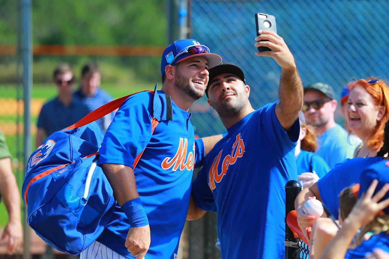 <p>New York Mets catcher Kevin Plawecki poses for a photo with a fan after spring training workouts in Port St. Lucie, Fla., Feb. 23, 2018. (Photo: Gordon Donovan/Yahoo News) </p>