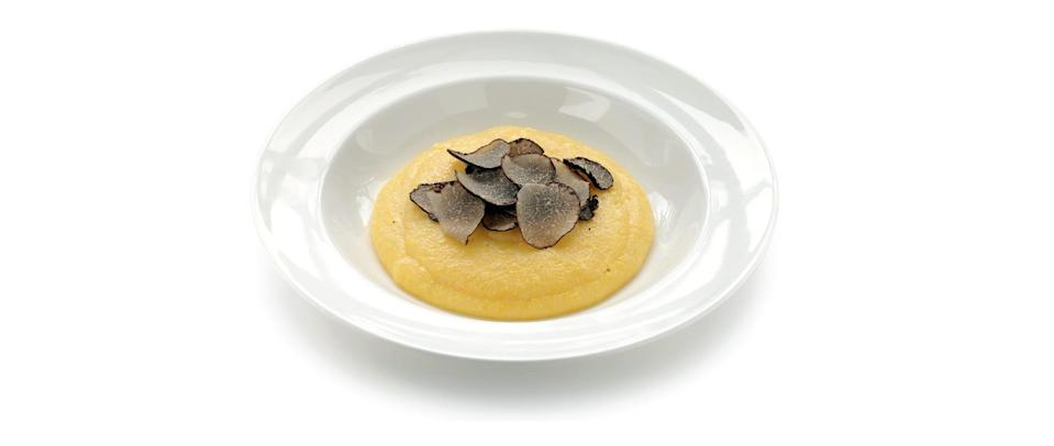 Black truffles served over polenta, a type of yellow cornmeal.