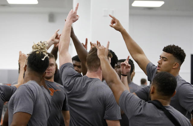 Members of the Texas Longhorns football team huddle during a morning workout Wednesday Sept. 4, 2019 in Austin, Tx. ( Photo by Edward A. Ornelas )