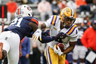 LSU running back John Emery Jr. (4) breaks free from Auburn defensive back Smoke Monday (21) as he carries the ball during the first quarter of an NCAA college football game on Saturday, Oct. 31, 2020, in Auburn, Ala. (AP Photo/Butch Dill)