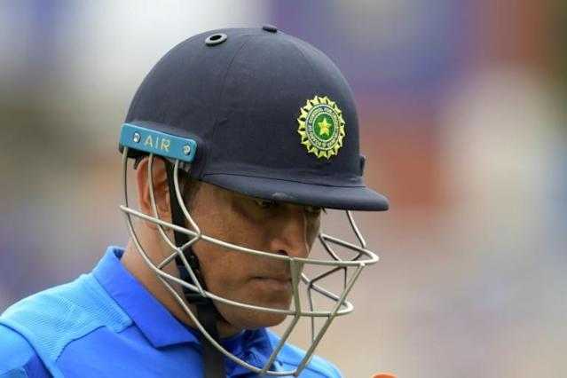 Mahendra Singh Dhoni has not appeared for club or country since New Zealand beat India in the World Cup semi-final in July 2019 (AFP Photo/Dibyangshu Sarkar)