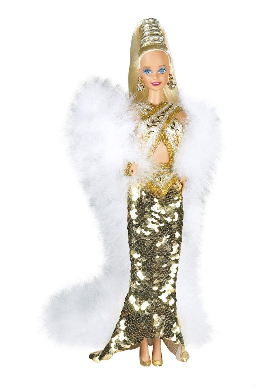 "<p>The '90s brings new designer collaborations to the Barbie world, like this Bob Mackie creation. </p><p><a href=""http://www.goodhousekeeping.com/home/g3758/90s-things-every-girl-bedroom/"" rel=""nofollow noopener"" target=""_blank"" data-ylk=""slk:The 15 things in every '90s room »"" class=""link rapid-noclick-resp""><em>The 15 things in every '90s room »</em></a></p>"