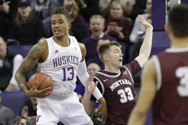 Washington's Hameir Wright (13) grabs a rebound next to Montana's Jared Samuelson (33) during the first half of an NCAA college basketball game Friday, Nov. 22, 2019, in Seattle. (AP Photo/Elaine Thompson)