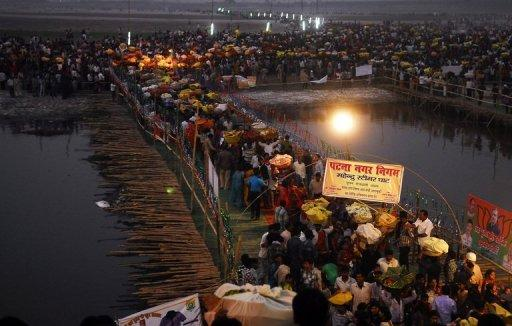 The stampede occurred when a makeshift bridge on the Ganges river gave way under the weight of Hindu devotees
