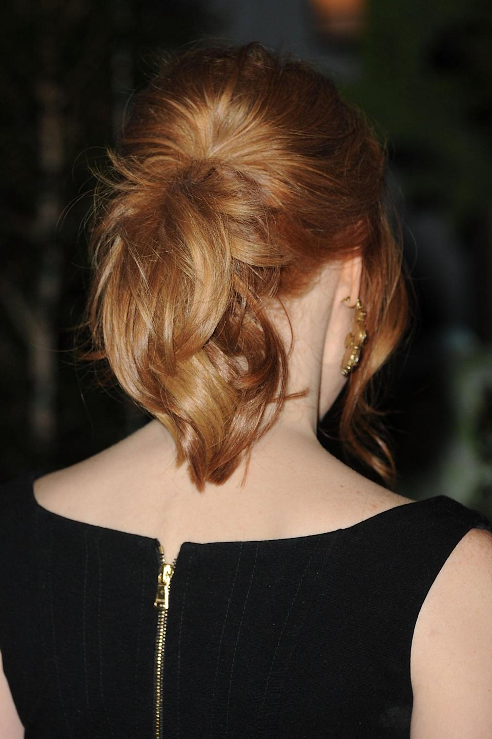 <p>Chastain had her layered hair up in a ponytail for a 2011 event.</p>