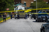 Police respond to the scene of a shooting at Heritage High School in Newport News, Va., on Saturday Sept. 20, 2021. Newport News police Chief Steve Drew said two students were shot and taken to the hospital and neither injury was thought to be life-threatening. The chief said authorities believe the suspect and victims knew one another but did not provide details. (AP Photo/John C. Clark)