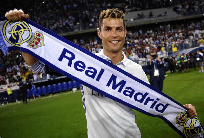 FILE - In this Sunday, May 21, 2017 file photo, Real Madrid's Cristiano Ronaldo celebrates after winning the Spanish La Liga title at the end of the soccer match between Malaga and Real Madrid in Malaga, Spain. Ronaldo, who joined Juventus for this season from Real Madrid, became the first player to win the English Premier League (with Manchester United), the Spanish league (with Madrid) and Serie A. (AP Photo/Daniel Tejedor, File)