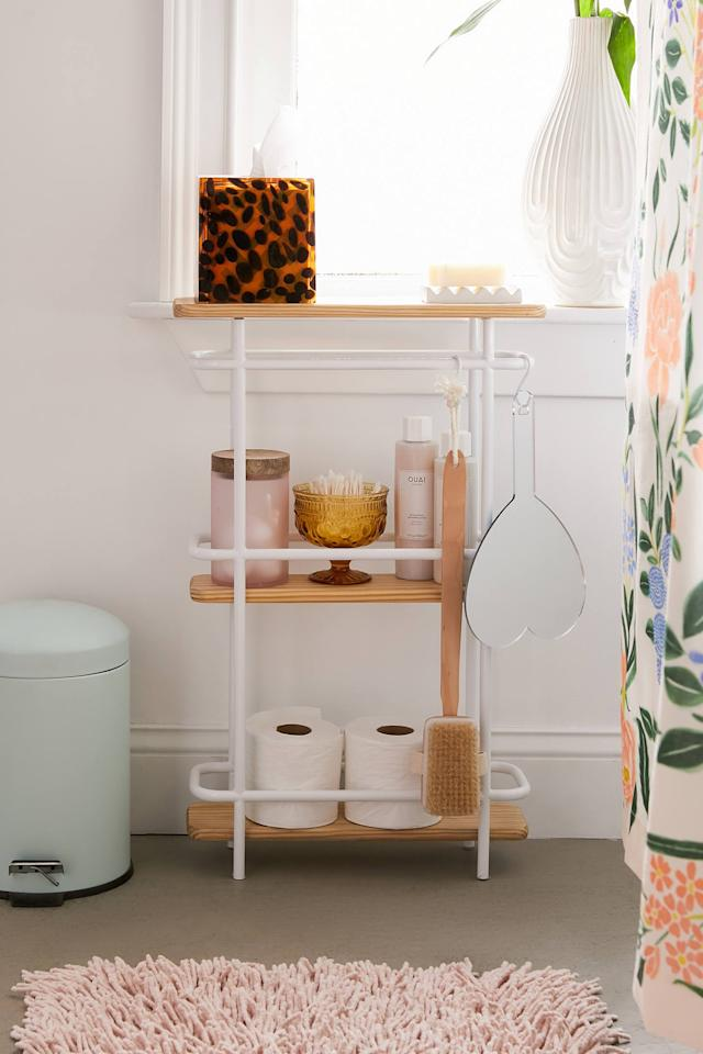 "<p>I love that this <a href=""https://www.popsugar.com/buy/Shelby-Bathroom-Storage-Shelf-548931?p_name=Shelby%20Bathroom%20Storage%20Shelf&retailer=urbanoutfitters.com&pid=548931&price=89&evar1=casa%3Aus&evar9=47214927&evar98=https%3A%2F%2Fwww.popsugar.com%2Fhome%2Fphoto-gallery%2F47214927%2Fimage%2F47217535%2FShelby-Bathroom-Storage-Shelf&list1=shopping%2Corganization%2Capartments%2Csmall%20space%20living%2Chome%20organization%2Chome%20shopping&prop13=api&pdata=1"" rel=""nofollow"" data-shoppable-link=""1"" target=""_blank"" class=""ga-track"" data-ga-category=""Related"" data-ga-label=""https://www.urbanoutfitters.com/shop/shelby-bathroom-storage-shelf?category=shelving&amp;color=010&amp;type=REGULAR"" data-ga-action=""In-Line Links"">Shelby Bathroom Storage Shelf</a> ($89) also features hanging hooks.</p>"
