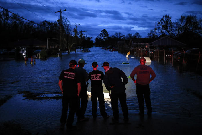 First responders prepare to launch rescue boats to transport residents out of floodwater left behind by Hurricane Ida in LaPlace, La., on Aug. 30, 2021. (Luke Sharrett / Bloomberg via Getty Images)