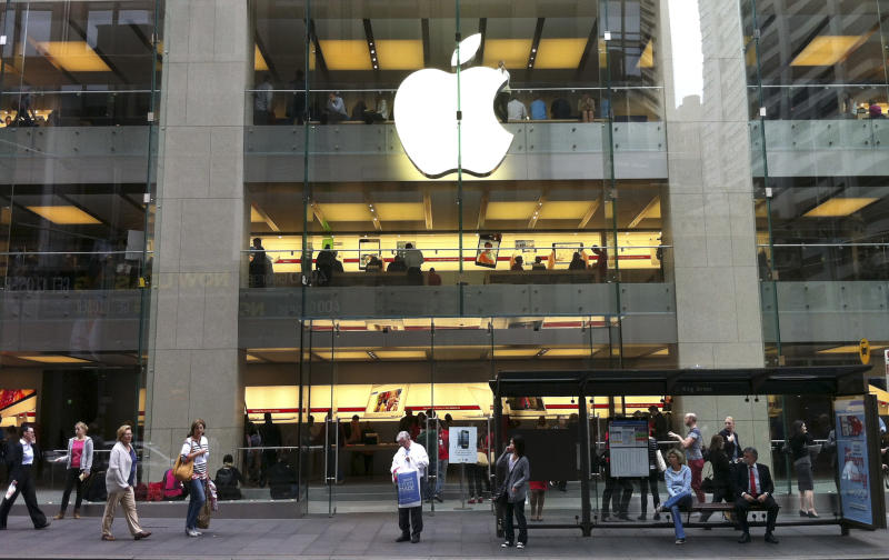 """People walk past an Apple store in Sydney's central business district in Australia, Tuesday, Dec. 11, 2012. Australian police are warning the public that errors in Apple's much-maligned mapping application are leading drivers headed to the southern city of Mildura to take a potentially """"life-threatening"""" wrong turn into the middle of a remote state park. Apple's Maps service places the city of Mildura about 70 kilometers (44 miles) away in the Murray Sunset National Park, a desert-like 5,000 square kilometer (1,900 square mile) region with scorching temperatures and virtually no mobile phone reception.(AP Photo/Rob Griffith)"""