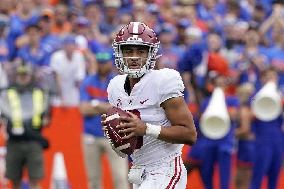 Alabama quarterback Bryce Young looks for a receiver during the first half of an NCAA college football game against Florida, Saturday, Sept. 18, 2021, in Gainesville, Fla. (AP Photo/John Raoux)