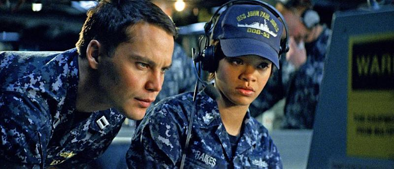 """In this film publicity image released by Universal Pictures, Taylor Kitsch, left, and Rihanna are shown in a scene from """"Battleship."""" """"Battleship,"""" a Universal Pictures movie based on the Hasbro Inc. board game, has survived an armada of tomato-throwing critics and chugged to $170 million in ticket sales overseas. The haul goes part way to justifying the reported $209-million price tag, but after subtracting splits with theater owners, it is estimated to need about half a billion at box offices to turn a profit. With a fleet of other hotly expected blockbusters surrounding its U.S. release on May 18, the tides need to be solidly in its favor to stay above water. (AP Photo/Universal Pictures)"""