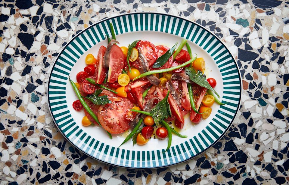 "This savory green bean and tomato salad is one of our favorite late-summer moves. Anchovies are not optional; they're an integral ingredient, so it's worth seeking out good ones. <a href=""https://www.epicurious.com/recipes/food/views/tomatoes-and-haricots-verts-with-anchovies?mbid=synd_yahoo_rss"" rel=""nofollow noopener"" target=""_blank"" data-ylk=""slk:See recipe."" class=""link rapid-noclick-resp"">See recipe.</a>"