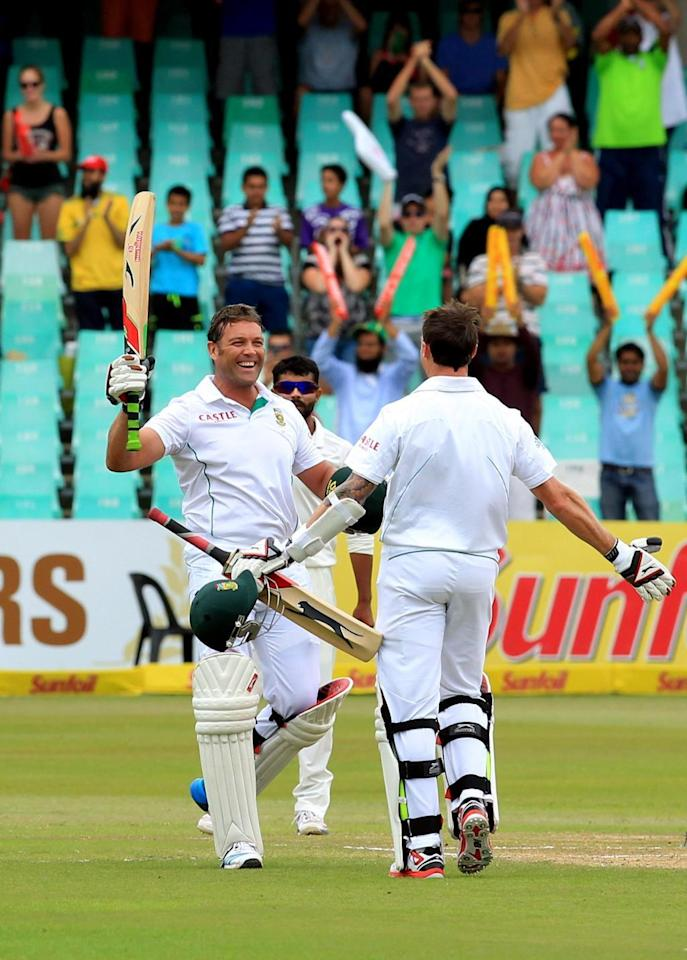 South African cricketer Jacques Kallis celebrates his century during the 4th Day of the Second Test match between India and South Africa played at Kingsmead Stadium in Durban on Dec.29, 2013. (Photo: IANS)