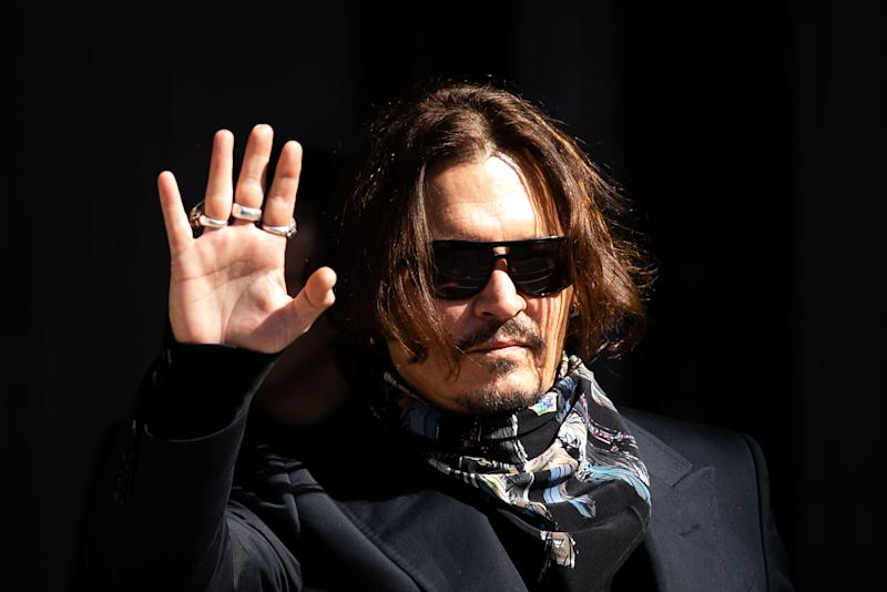 Actor Johnny Depp arrives at the High Court in London for a hearing in his libel case against the publishers of The Sun and its executive editor, Dan Wootton.