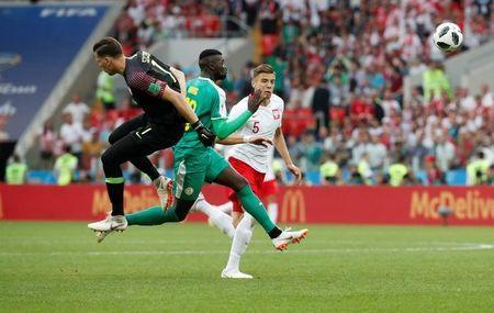 Poland's Wojciech Szczesny and Jan Bednarek in action with Senegal's M'Baye Niang. REUTERS/Christian Hartmann