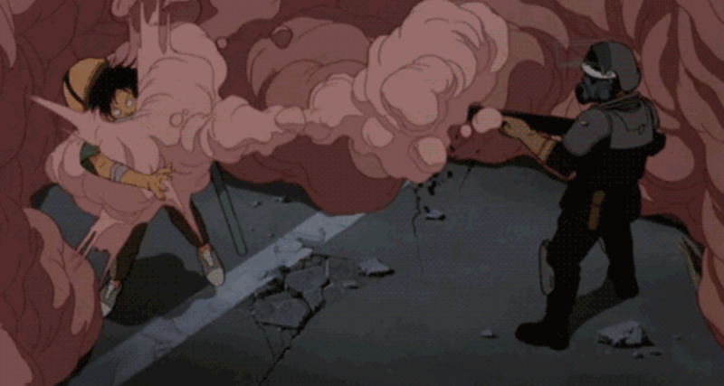 A protester gets hit with a smoke canister in Akira. (Toei Animation)