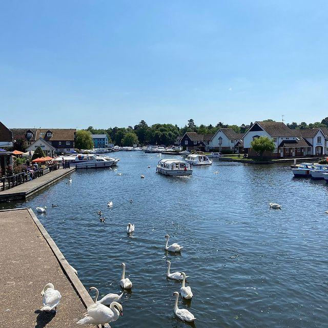 """<p>The capital of the Norfolk Broads, Wroxham sits on the bank of the River Bure and is a great spot to hire a boat for a day to explore the national park. You'll find shops, pubs and restaurants, as well as the mainline railway station and <a href=""""https://www.countrylivingholidays.com/tours/norfolk-broads-rail-tour"""" rel=""""nofollow noopener"""" target=""""_blank"""" data-ylk=""""slk:Bure Valley Railway"""" class=""""link rapid-noclick-resp"""">Bure Valley Railway</a> station.</p><p><a class=""""link rapid-noclick-resp"""" href=""""https://www.countrylivingholidays.com/tours/norfolk-broads-rail-tour"""" rel=""""nofollow noopener"""" target=""""_blank"""" data-ylk=""""slk:VISIT WROXHAM DURING A RAIL TRIP TO NORFOLK"""">VISIT WROXHAM DURING A RAIL TRIP TO NORFOLK</a></p><p><a href=""""https://www.instagram.com/p/CP1WsMCpO04/"""" rel=""""nofollow noopener"""" target=""""_blank"""" data-ylk=""""slk:See the original post on Instagram"""" class=""""link rapid-noclick-resp"""">See the original post on Instagram</a></p>"""