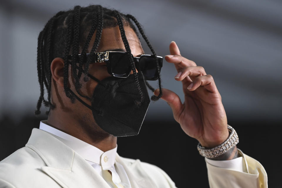 LSU wide receiver Ja'Marr Chase adjusts his glasses as he appears on the Red Carpet at the Rock & Roll Hall of Fame before the NFL football draft, Thursday, April 29, 2021, in Cleveland. (AP Photo/David Dermer, Pool)