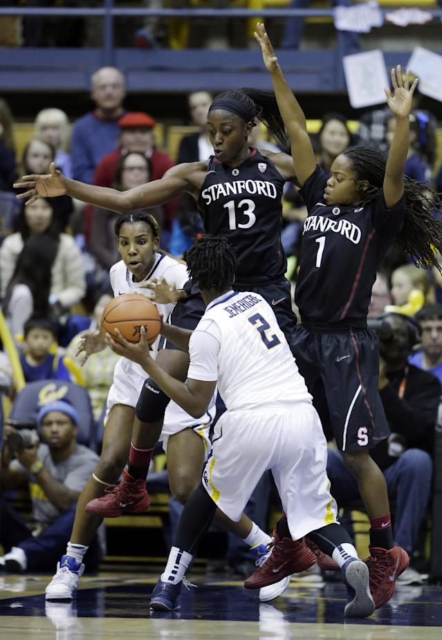 Stanford forward Chiney Ogwumike (13) and guard Lili Thompson (1) defend on California guard Afure Jemerigbe (2) during the first half on an NCAA college basketball game on Sunday, Feb. 2, 2014, in Berkeley, Calif. (AP Photo/Marcio Jose Sanchez)