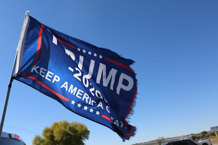 A Trump campaign flag waves from the bed of Las Cruces resident Vincent Kelly's truck outside of Fairacres Elementary School on Tuesday Nov. 3, 2020.